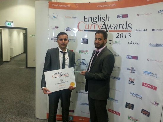 """Shimla Spice Restaurant: Our management collecting the """"BEST INDIAN RESTAURANT IN ENGLAND"""" 2013 award"""