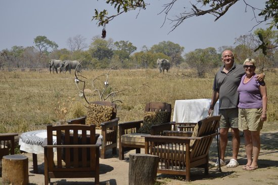 Luwi Bush Camp - Norman Carr Safaris : View over the plain in front of camp with guests arriving for drinks!!