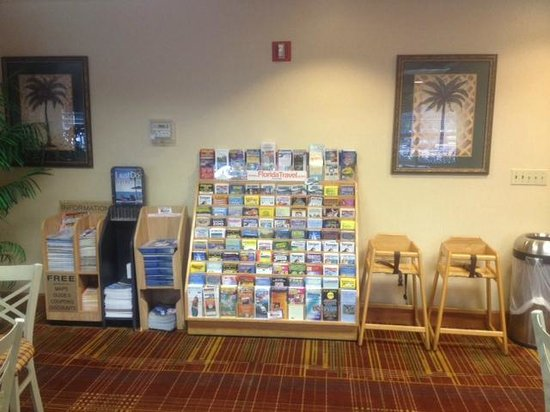 Allure Suites: Vacation brochures and coupons in the breakfast area