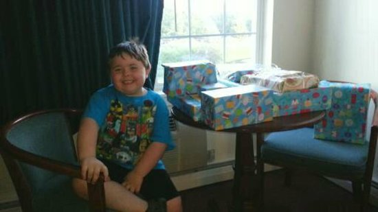 Coos Motor inn : My son with his presents. Sitting at the table.