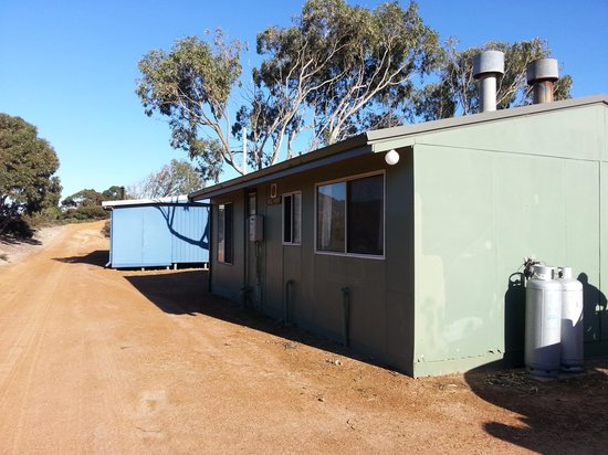 Orleans Bay Caravan Park: outside large cabins