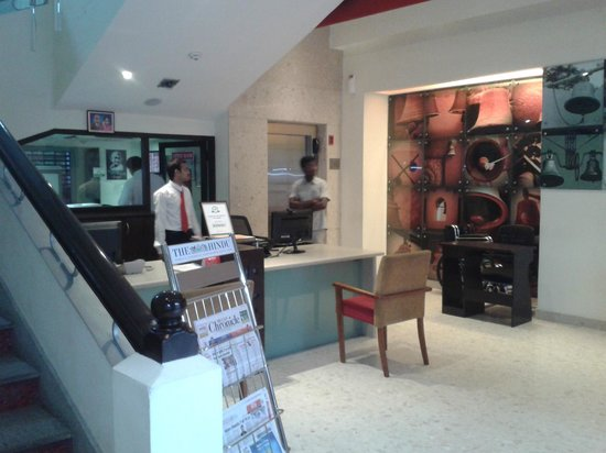 Bell Hotel - Chennai: The lobby with a photo mural of 'Bells'