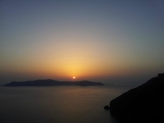 Ikastikies: Sunset from the private balcony of Oia suite