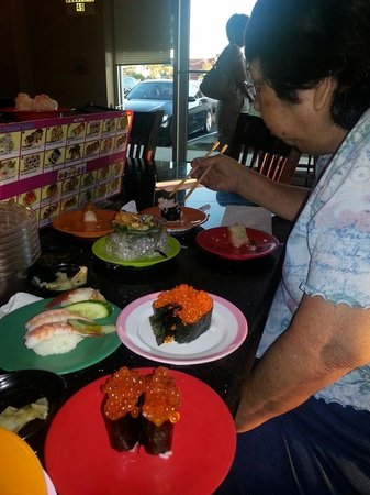 Belt Sushi and Roll: My mom enjoying her meal.