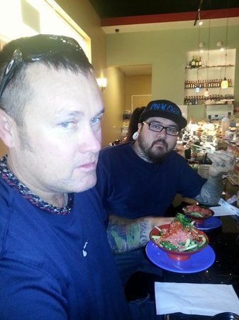 Belt Sushi and Roll: My husband and son having fresh poke.