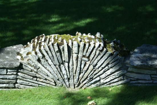 Mushroom Houses of Charlevoix: Mushroom Houses Charlevoix-Signature stone fence structure of Earl Young