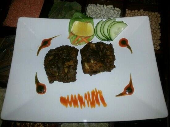 khan Tandoori : Cod fish marinated in mint, served with plum sauce and mint sauce