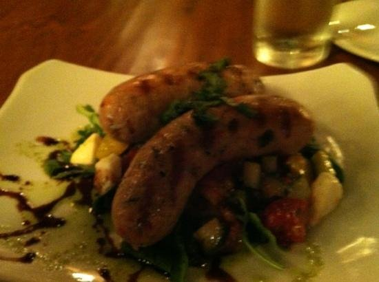 El Moro Spirits & Tavern : chicken sausage on greens (instead of bread) with a wonderfully tasty dressing