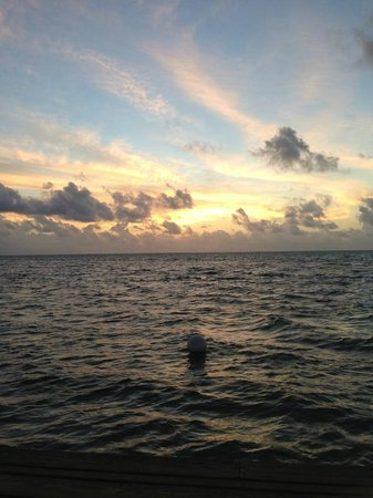 Grand Caribe Belize Resort and Condominiums: Sunrise view from the pier