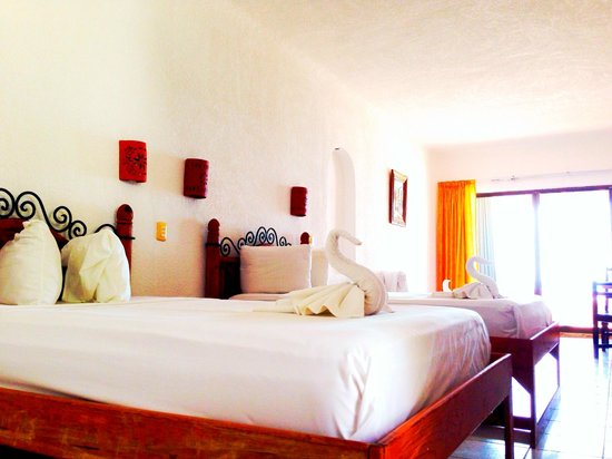 Pelicano Inn: Habitacion vista al jardin