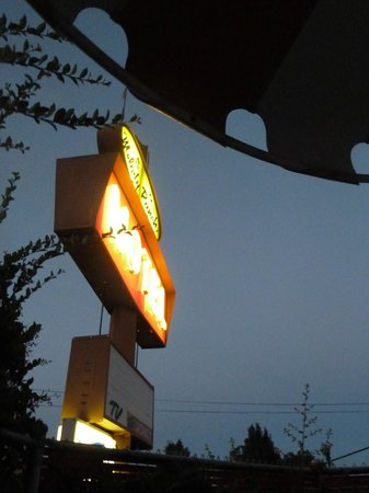 Melody Ranch Motel: the motel sign at night from under the umbrella- very atmospheric!