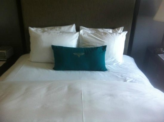 Inn at the WAC: Bed with a logo cushion
