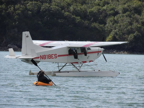 Kingfisher Aviation: Glenn (pilot) had to kayak to the plane after the tide came in