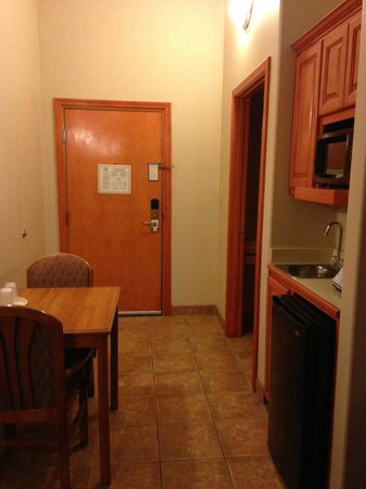 Holiday Inn Express Hotel & Suites Brownsville: Table, Microwave, and fridge