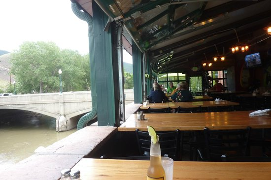 Boathouse Cantina: Bar with open window views of the river