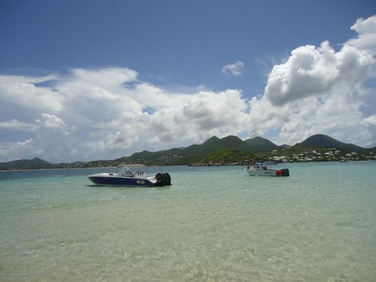 Captain Alan's Three Island Snorkeling Adventure: View from Pinel Beach, Awsome Boat on right