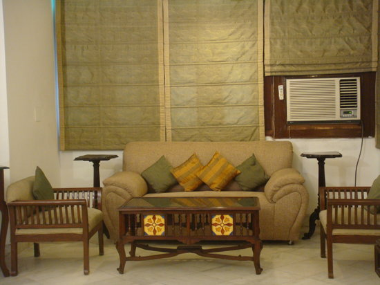 Tej Abode : Couch Seating in the room.