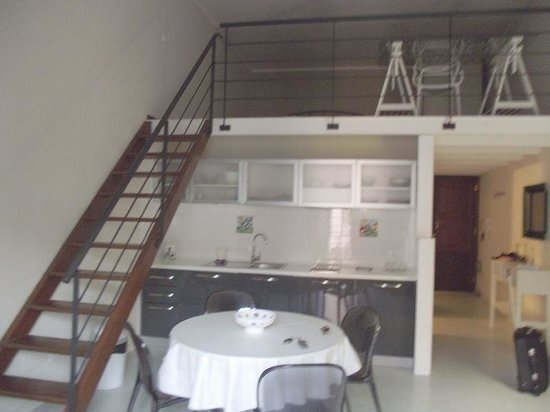 Residence Palazzo Ossuna: Living-room / kitchen & loft bedroom