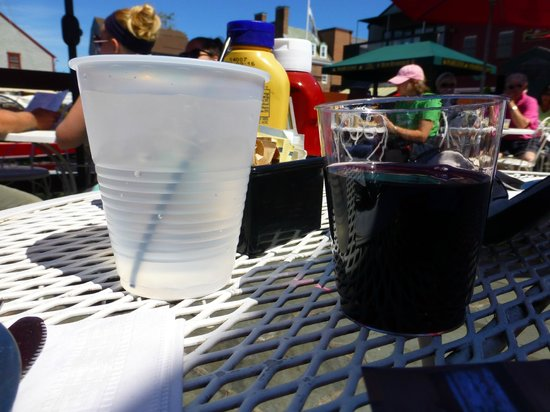 Black Pearl: Tiny glass of wine in PLASTIC--appalling.