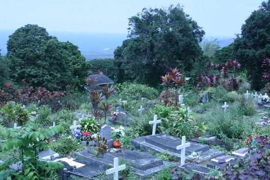 The Painted Church: The cemetery and view of the Kona coast in the background
