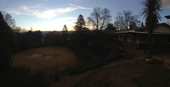 Tumble In: Main house, gardens and mountains at sunset
