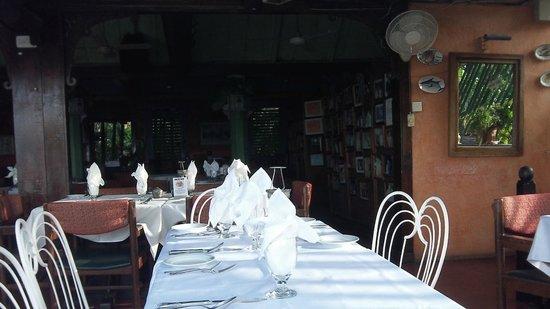 "Evita's Italian Restaurant: The outdoor dining area, looking down over ""Ochie"""