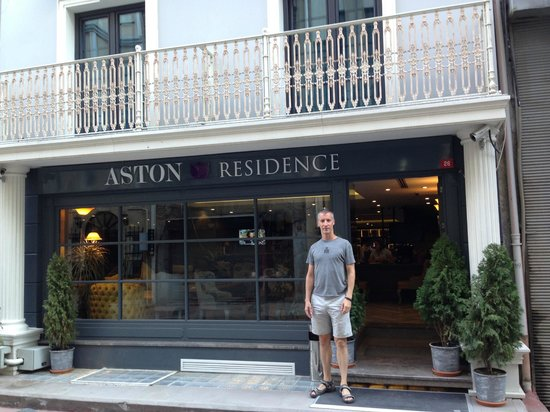 Tim in front of Aston Residence
