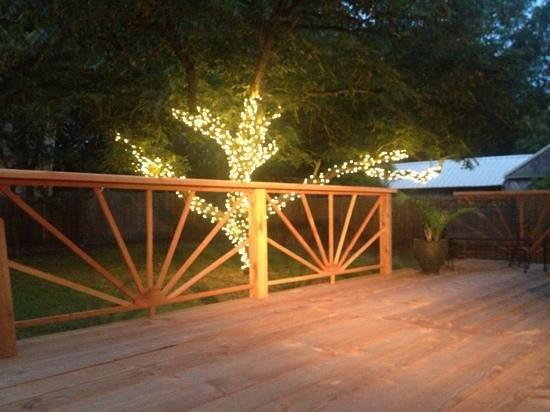 Angels Gate B&B : back deck and lit pecan tree.