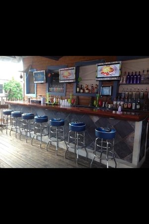 Castaway's: Nice and breezy upstairs bar with beers on tap and TVs for sports