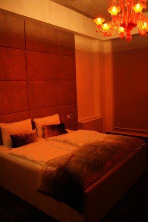 G Design Hotel : Water bed with orange chandelier.