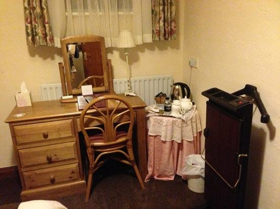 Sandhole Farm: The pink table cloth and trouser press in the small room