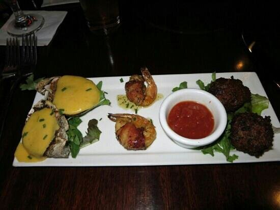 Middle Grounds Grill : mushroom filled oysters with bernaise sauce, bacon rolled shrimps, and crab cakes with kind of s