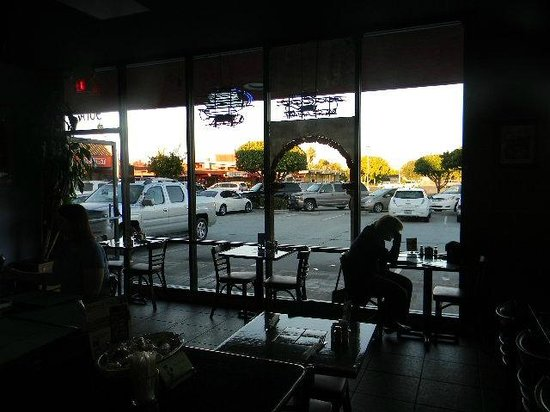 TIA Juana Restaurant: view from inside of glass wall and parking lot outside
