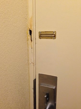 The St. Clair Hotel: Security chain ripped from the door frame.. That's reassuring...