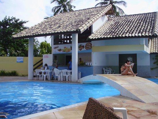 Sunshine Praia Hotel : Ponte sobr a piscina, no fundo bar e Sauna