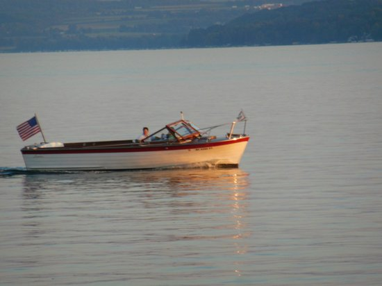 Skaneateles Suites: Lyman Boat on the lake on a summer evening