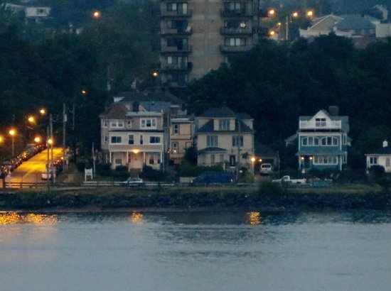 The Harbor House: Harbor House viewed as I passed in cruise ship~ house on the left. Porch light is on to welcome