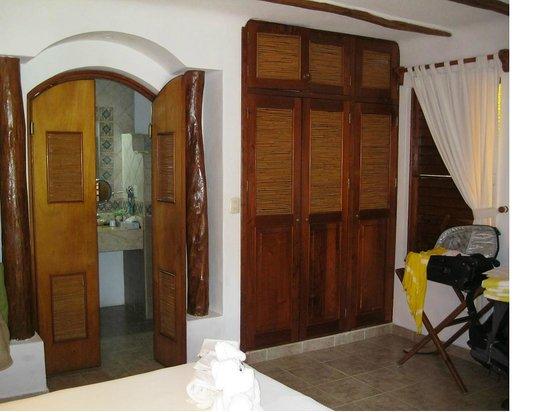 Mahekal Beach Resort : the bathroom is thru the double doors, beautiful wood inside