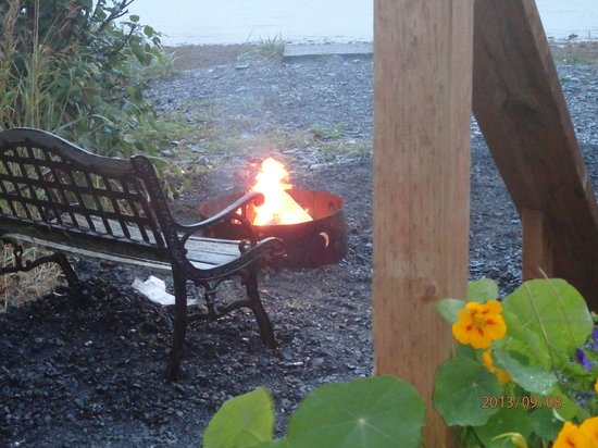 Angels Rest on Resurrection Bay, LLC : A cozy seaside firepit & bench.