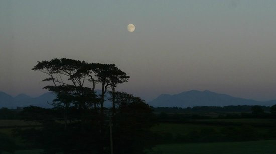 Moon over Snowdonia mountains from Drws-y-Coed