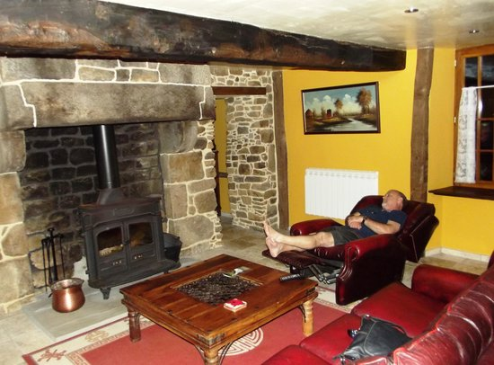 Cherence-Le-Roussel, France : Napping by the fireplace under original 17th century beams.
