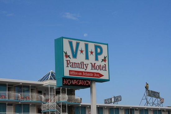 V.I.P. Family Motel: early morning, tried to frame the moon above the I to make it look like an lowercase i