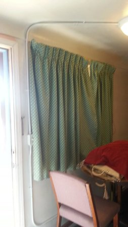 Bay Motel: these curtains wouldn't close right,smelled, and were smokey yellow instead  of white