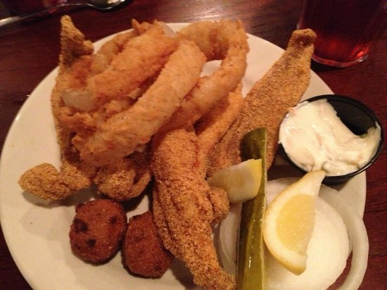 Nick's Bar-B-Q & Catfish Restaurant: catfish with onion rings and brown beans in a bowl on the side.