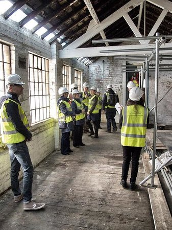 Coffin Works: Being shown the roof repairs