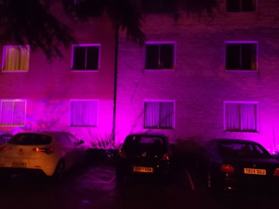 Larkfield Priory Hotel: At night the hotel facade is a host of coloured light