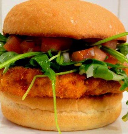 Chicken Milanese Burger: Breaded chicken breast garnished with freshly ...