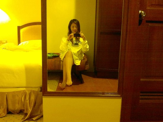 Sarrosa International Hotel and Residential Suites : a picture of me shown in the full body mirror (getting ready for a good night's rest)