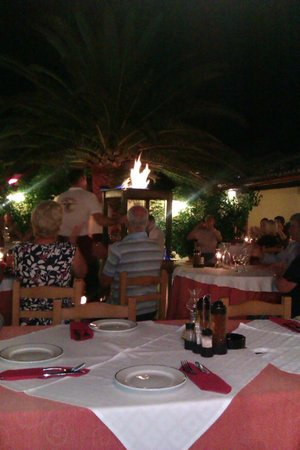 Zorbas: Tables on fire.