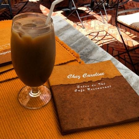 chez caroline: iced coffee. the menu is made with daphne paper. a nice touch.